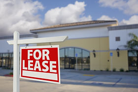 Vacant Retail Building with For Lease Re
