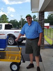 The food comes in on pickup trucks, is organized into boxes, and is given to needy families.