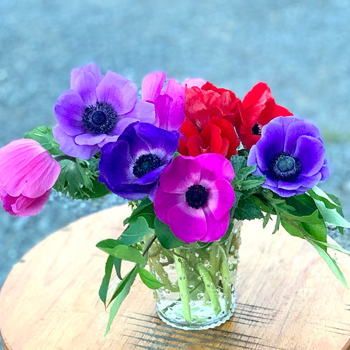 Mother's Day anemones in low and wide hobnail vase