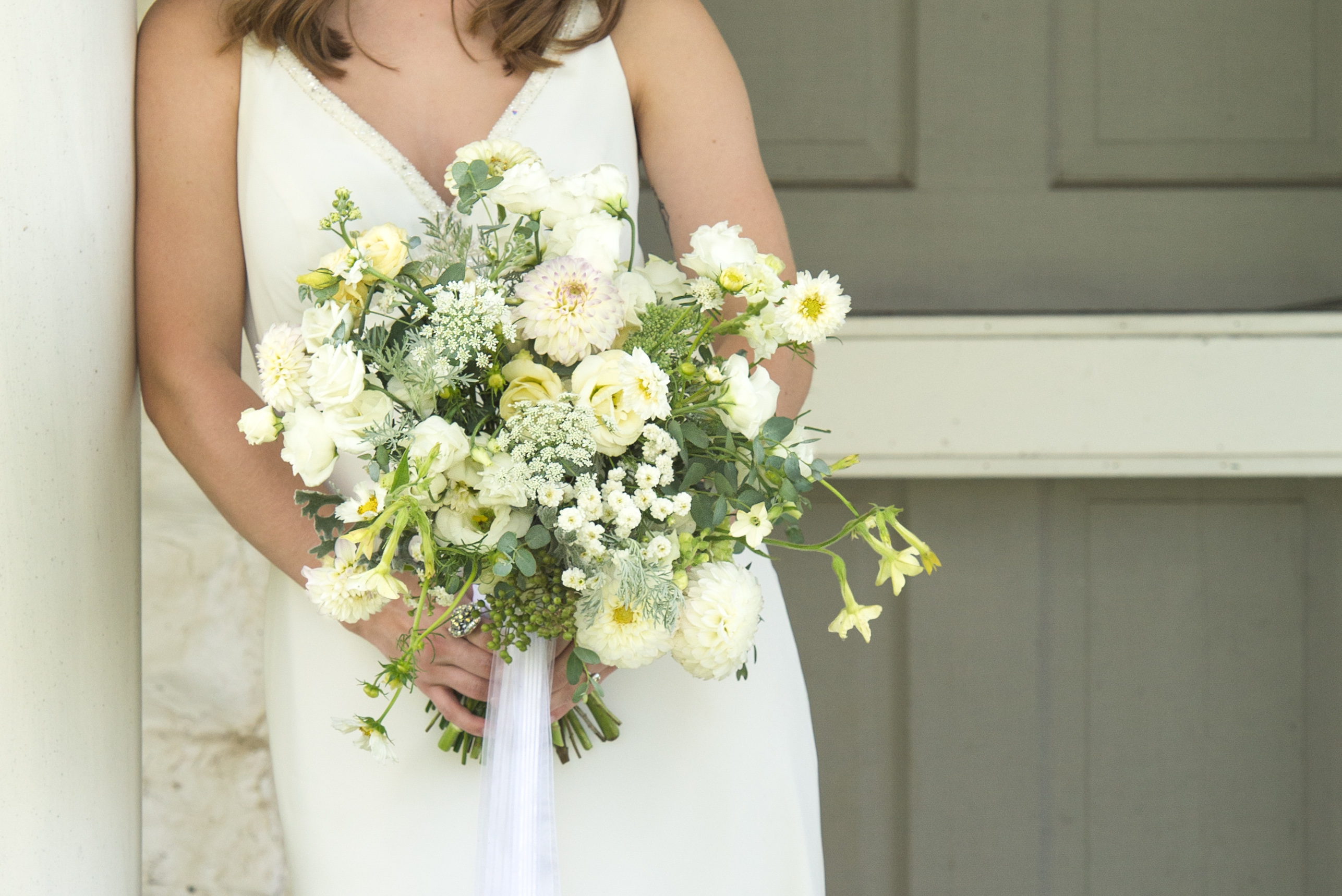 close up of all-white bridal bouquet