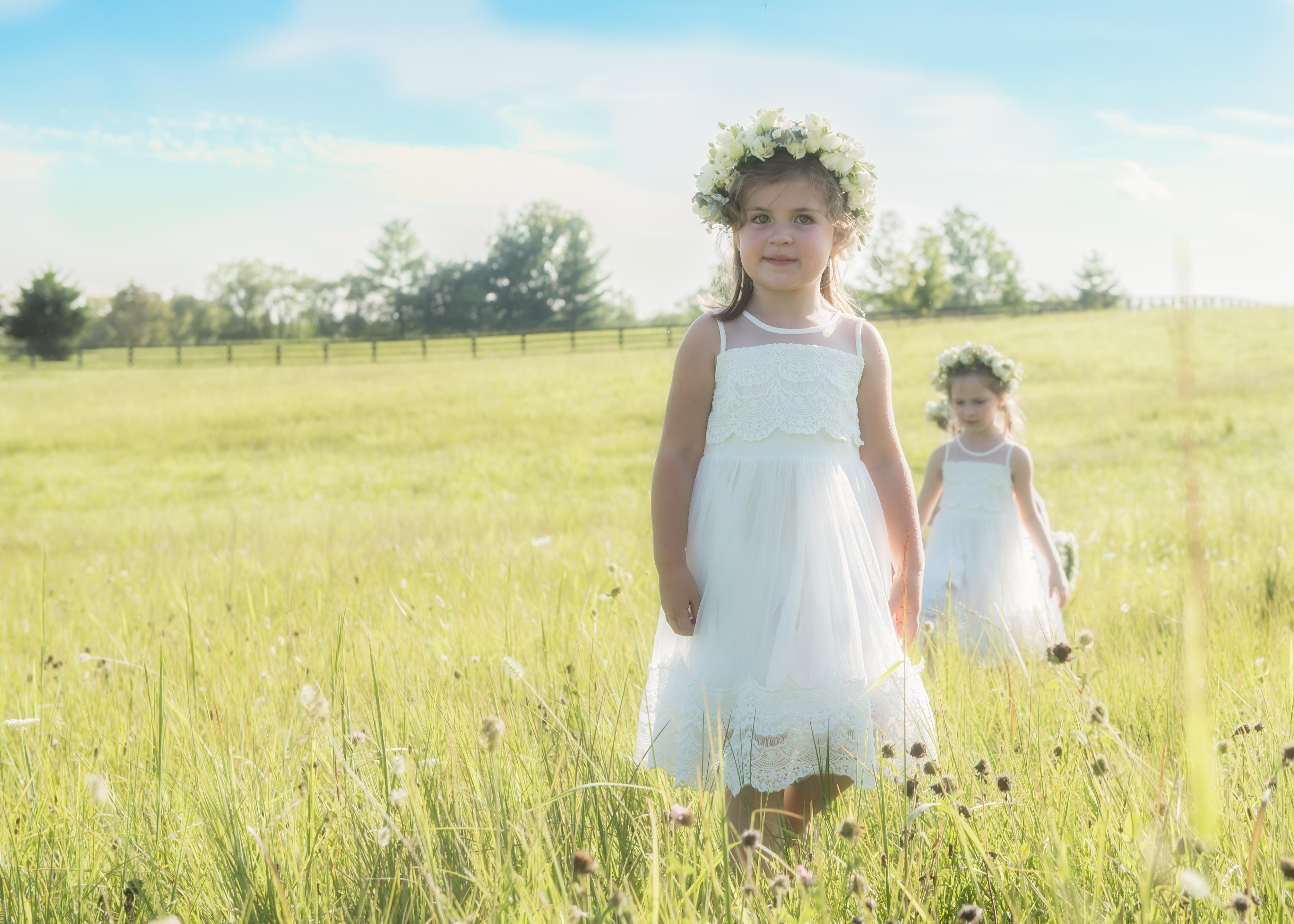 flower girls walking through fields