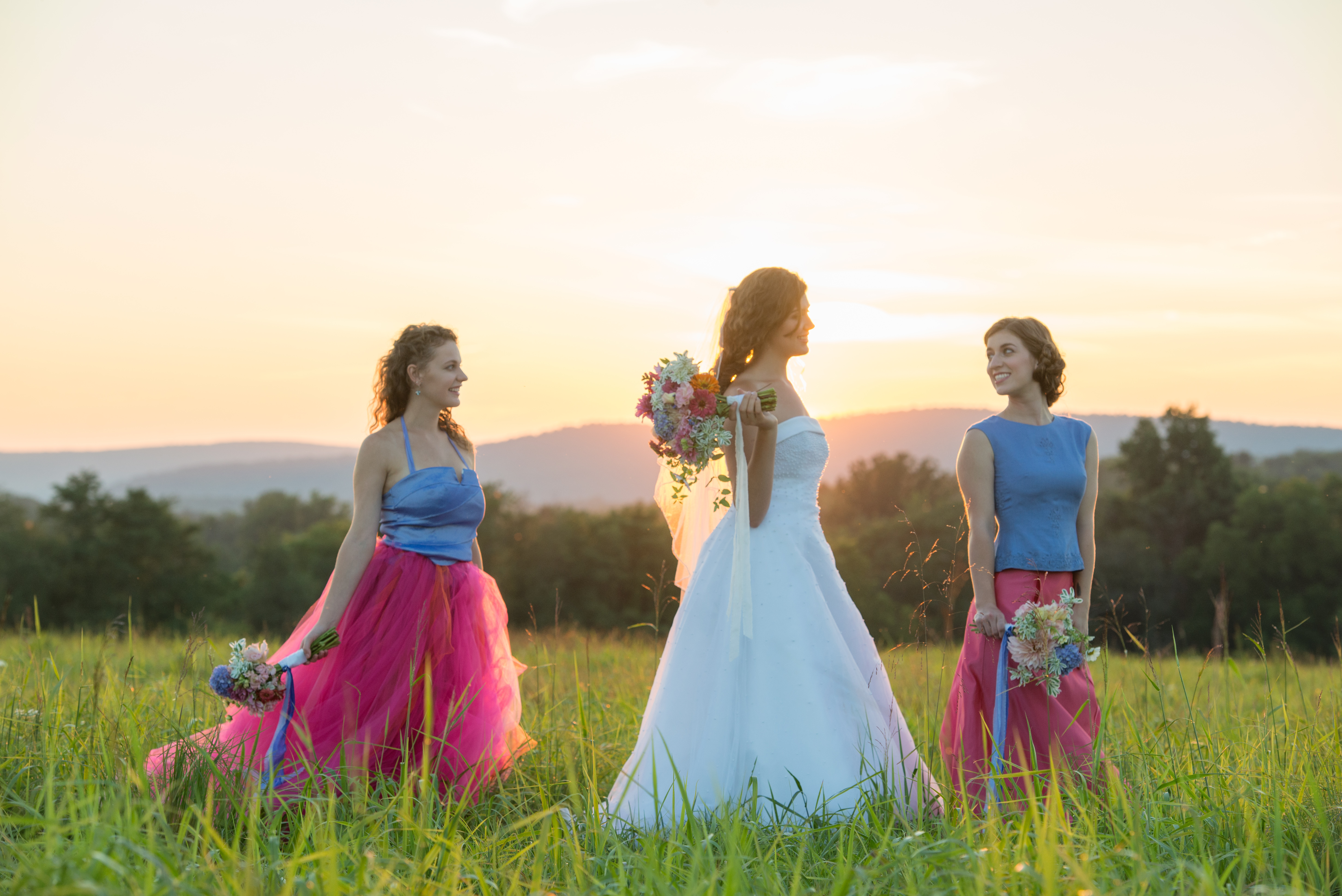 bride and maids at sunset