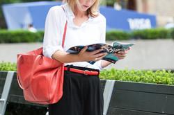 Woman reading TIFF schedule