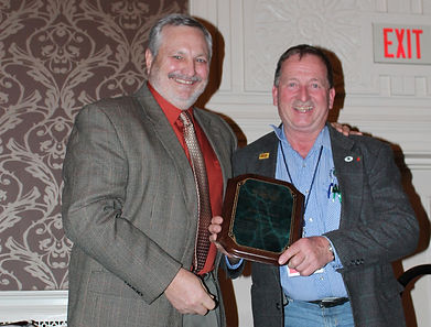 PVGA, President Dave Miller (left) presents the Life Membership Award to Robert Black (right), Catoctin Mountain Orchard, Thurmont, MD.   Photo republished with the permission of Lancaster Farming.