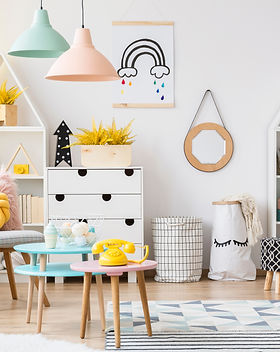 Yellow pouf near pink table with a phone