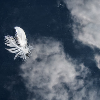 By Jan Arnold - Feathery Clouds