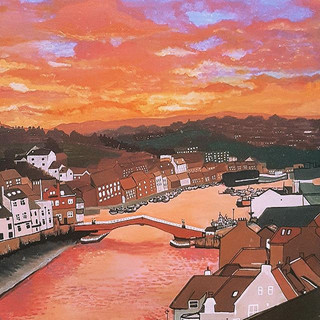 Orange sunset over Whitby Harbour