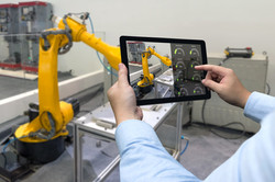 Engineer hand using tablet, heavy automation robot arm machine in smart factory industrial with tabl