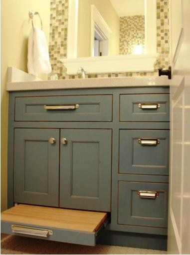 SCM Design Group built in pullout step in child's bathroom
