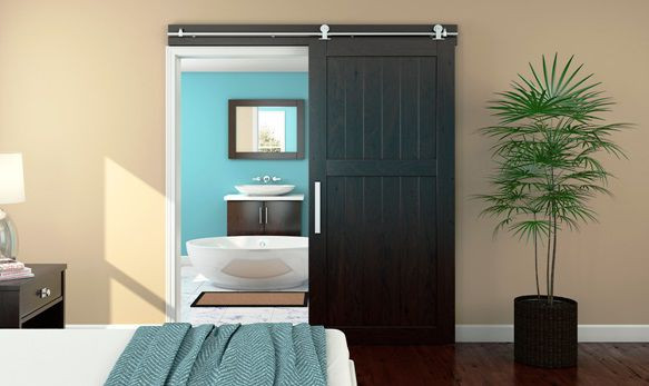 SCM Design Group sliding door leading into bathroom