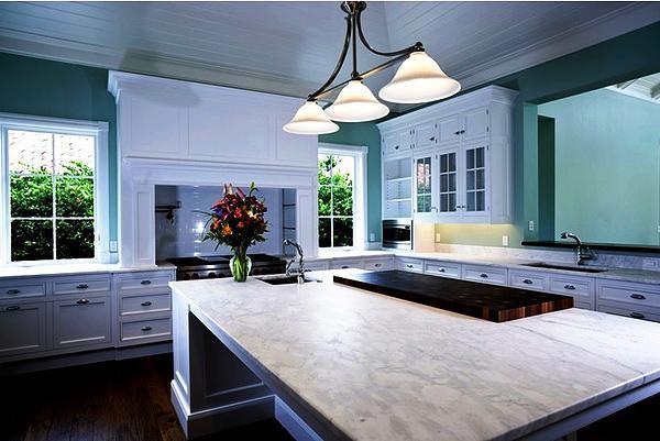 SCM Design Group carrara marble in green kitchen