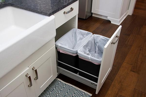 SCM Design Group pullout drawer double trashcans