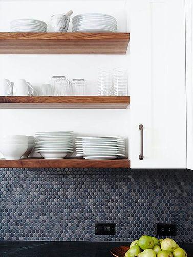  SCM Design Group natural wood shelving contrasting with white cabinets and blue backsplash