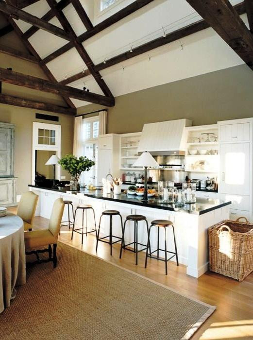 SCM Design Group neutral toned kitchen with dark espresso wooden beams