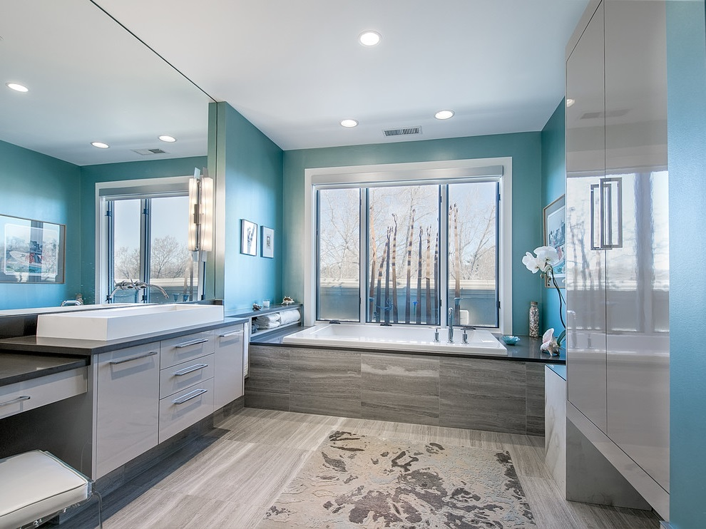 SCM Design Group teal wall bathroom