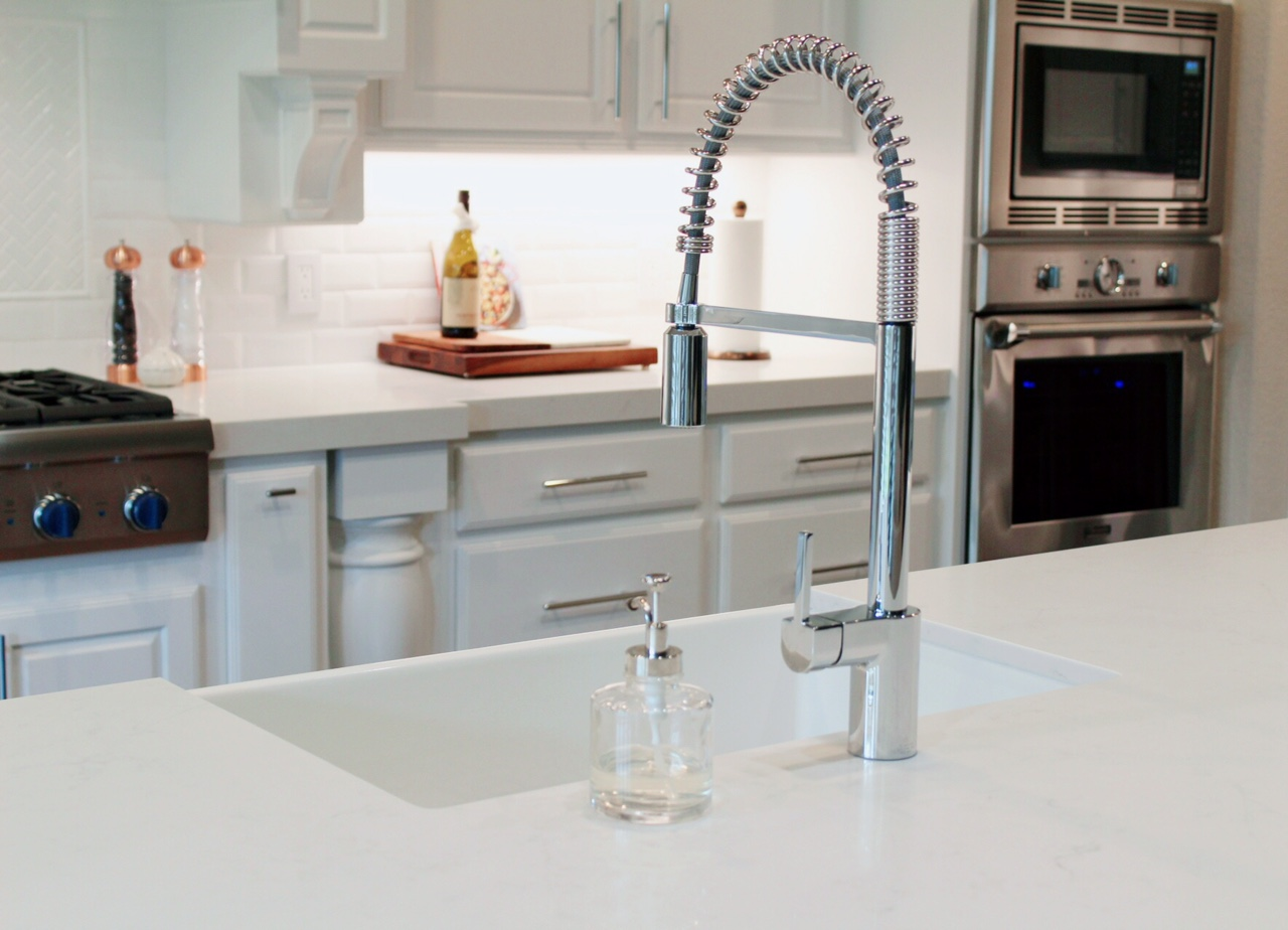 SCM Design Group tall kitchen faucet