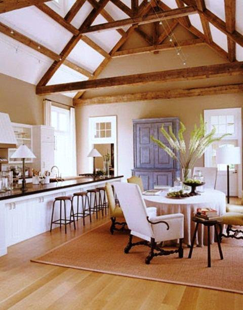 SCM Design Group bright kitchen with exposed wood beams