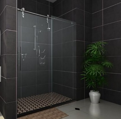 SCM Design Group frameless shower with black tiles