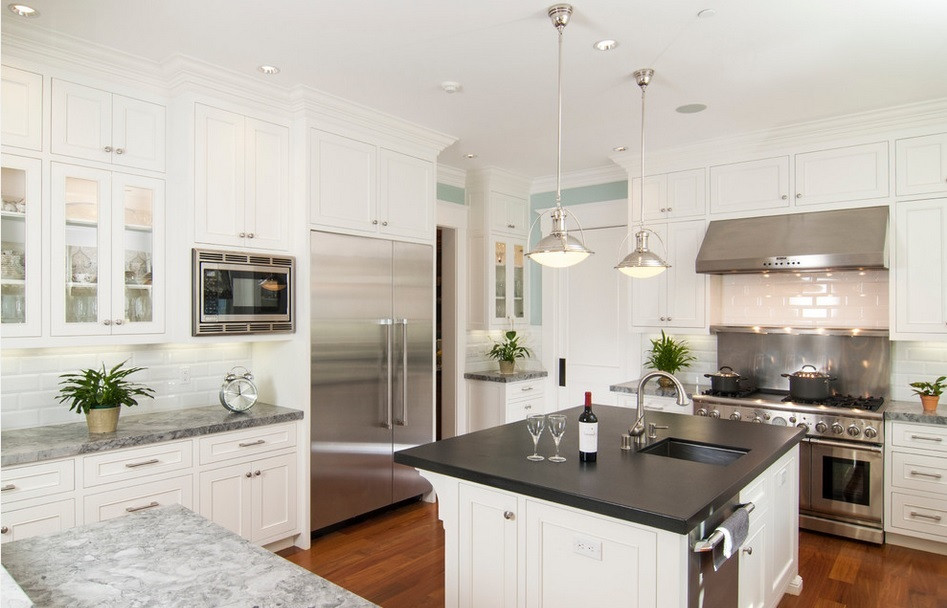 SCM Design Group white kitchen with black island