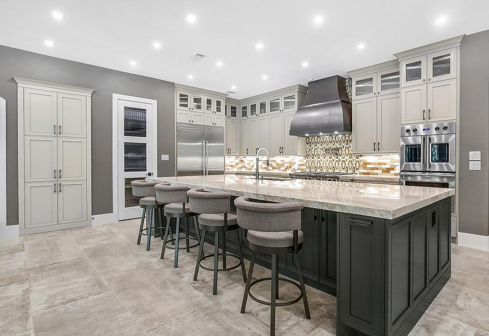 SCM Design Group transitional kitchen with mixed tile backsplash