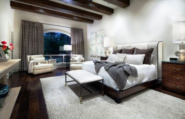 ​ ​​SCM Design Group large bedroom with exposed beams
