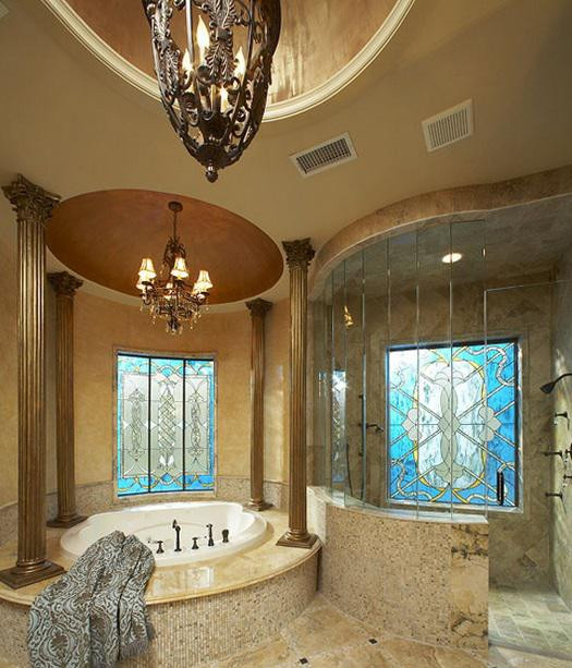 SCM Design Group venetian style master bath with columns around built-in spa