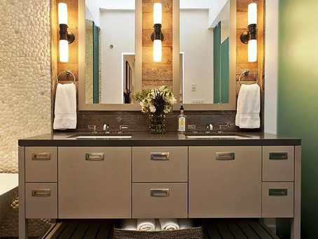 Cross illumination with wall sconces for your bathroom.