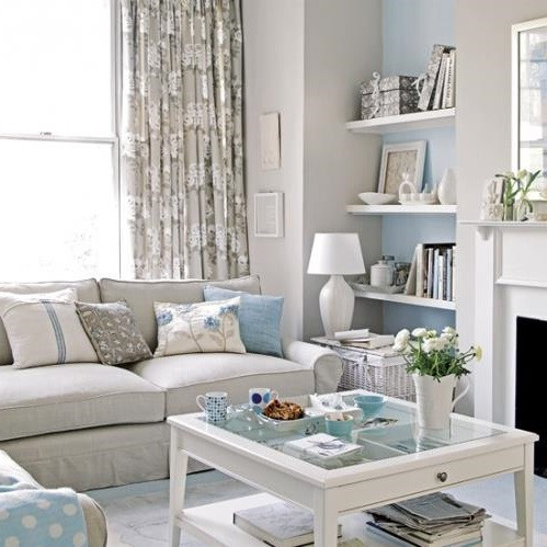 SCM Design Group neutral living room with blue accents