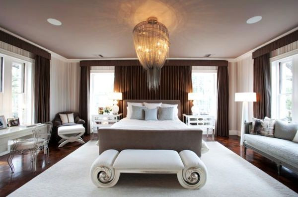 SCM Design Group elegant bedroom with large chandelier