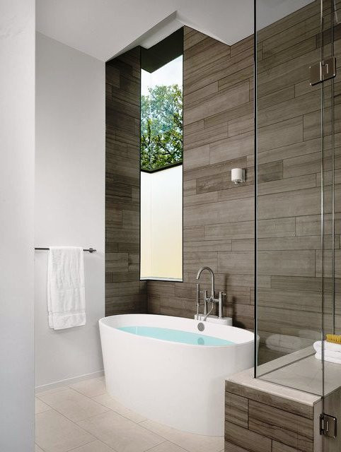 SCM Design Group freestanding tub in wood panel corner