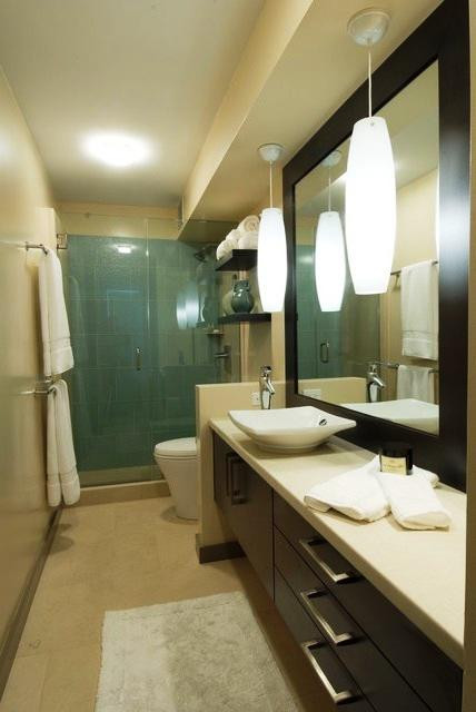SCM Design Group green glass shower with wall mounted vanity