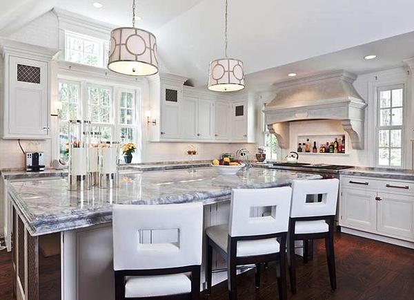 SCM Design Group carrara marble island in quaint kitchen