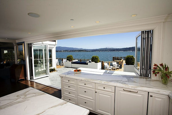  SCM Design Group kitchen with glass walls opening to scenic patio