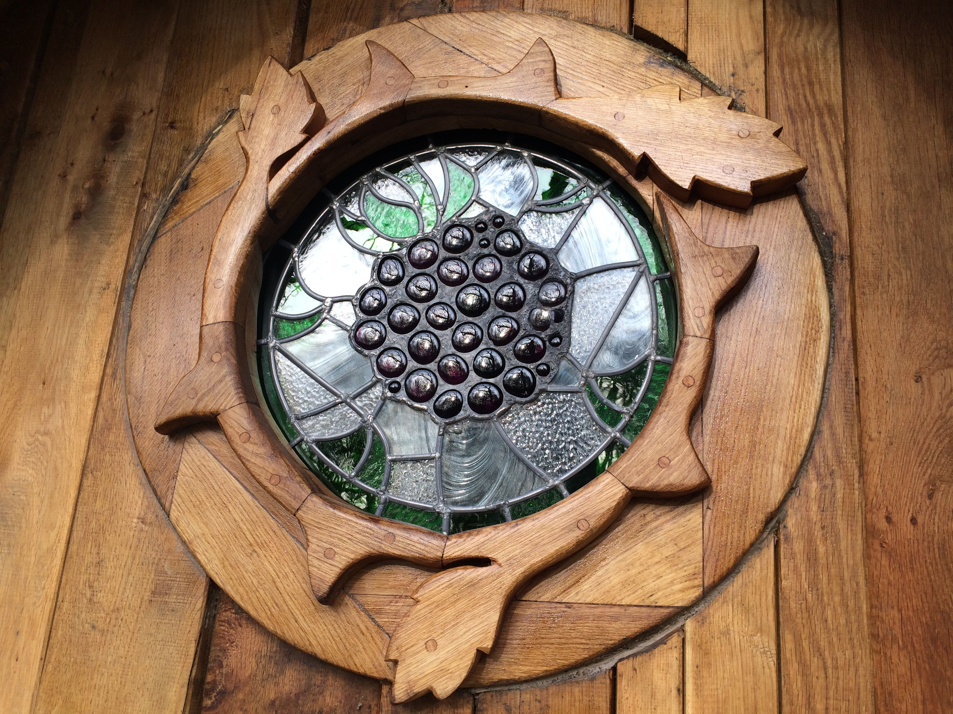 Carved wood and stained glass window