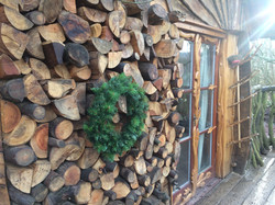 Blackberry Wood campsite treehouse log wall