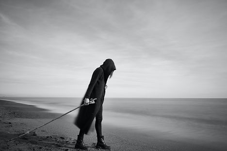 woman-in-black-cloak-with-fishing-pole-s