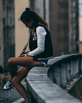 young-woman-sitting-on-bridge-depressed