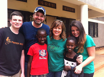 Our family with two of the seven children we sponsor in Rwanda