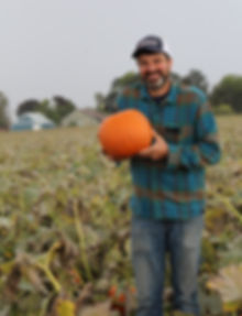 Farmer Bob holding what makes us who we are!