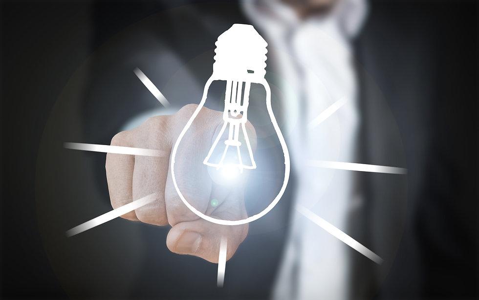 Canva - Hand Touching Lit Lightbulb.jpg