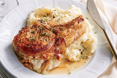 Pork chop with mashed potatoes and vegetables