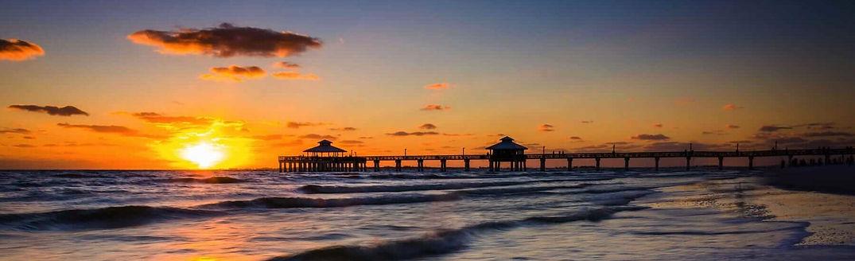 fort-myers-beach-sunset-pier-1800x550-c-