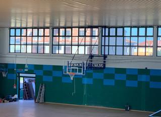 Comune di serdiana . Palestra scolastica .Impianto basket a muro chiudibile a libro .