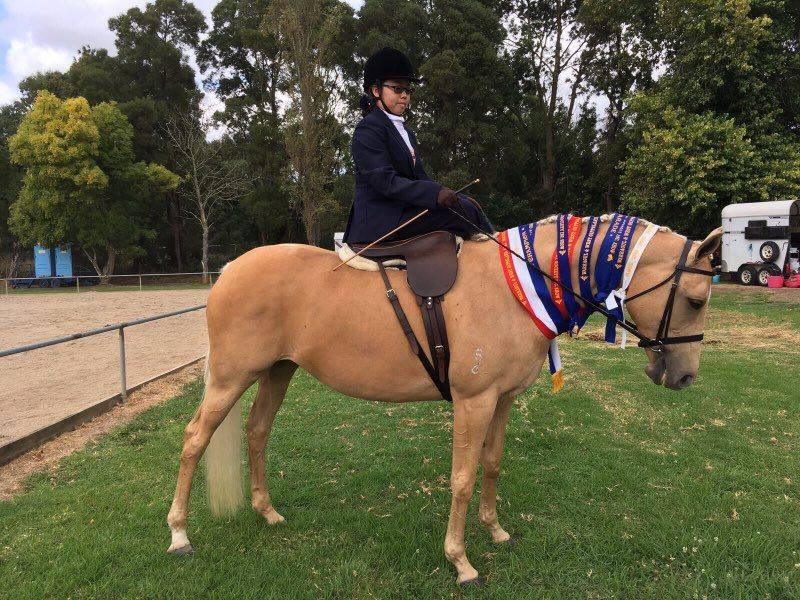 Student Weng in our side saddle and habit.