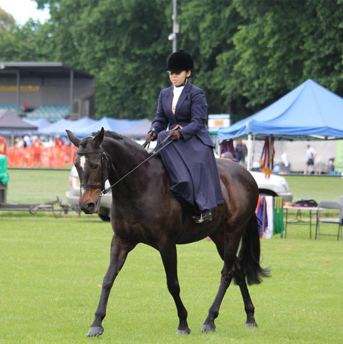 Student Weng in out side saddle and habit.