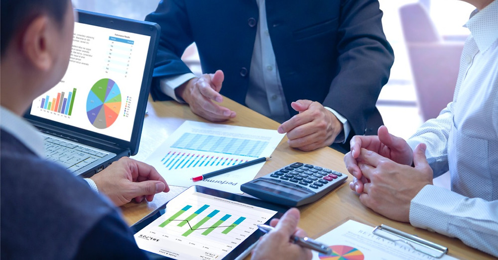 Reviewing a financial report during a business appraisal