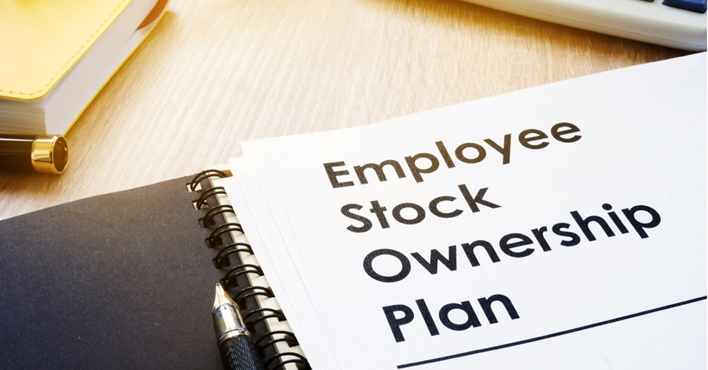 Binder with your Employee Stock Ownership Plan (ESOP) ready to be reviewed.