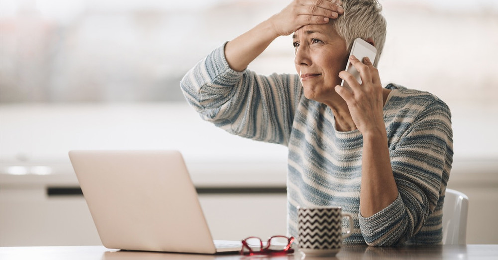 Senior woman on the phone with a scammer.