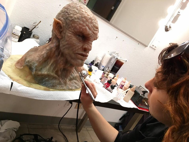 Airbrushing silicone mask with acrylic ink