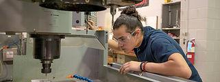 CNC Machinist Working on Machine
